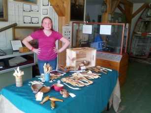 Wood Carver Tim Connolly's cutie pie daughter watching her pops' booth