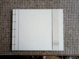 White linen Japanese stab bound photo album. Nice and large for lots of pictures.