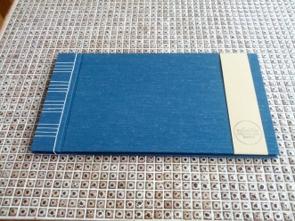 Black paper photo album. Japanese stab bound with blue mohair book cloth, hand sewn with linen thread and made with love.