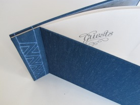Blue mohair guest book with blue linen thread. Stab bound with lined recycled paper.